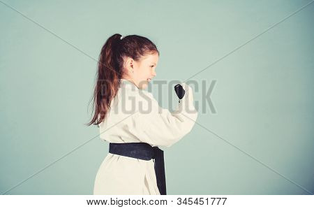 Power And Balance. Sport Success In Single Combat. Small Girl In Martial Arts Uniform. Practicing Ku