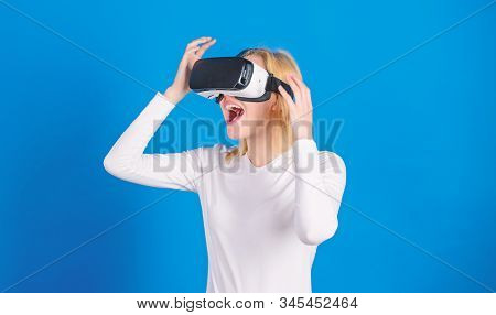 Woman Watching Virtual Reality Vision. Woman Using Virtual Reality Headset. Funny Woman Experiencing