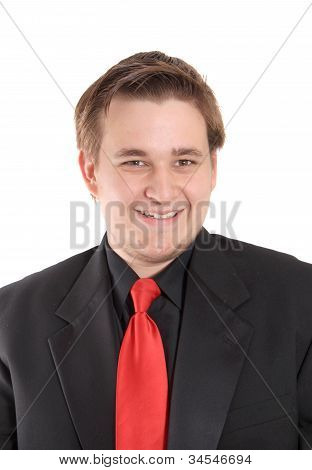 Young Businessman In Black Suit Smiling