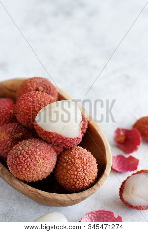 Fresh Litchi Fruits In A Bowl In A White Table Close Up
