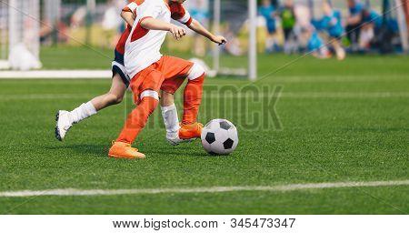 Boy Kicking Soccer Ball. Running Soccer Football Players. Five Junior Footballers On Duel. Football