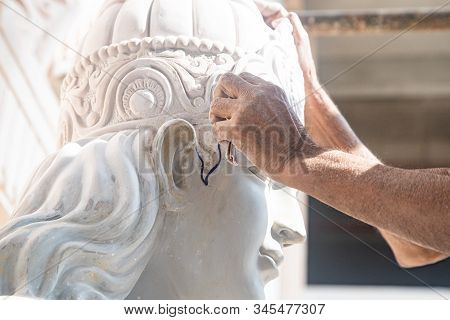 Close Up Of Man Ceramist Hands Holding A Tool And Working On Sculpture Details