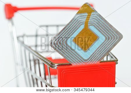 Blue Rfid Tag On Supermarket Trolley. Goods Security And Alarm. Shoplifting Prevention. Free Space F
