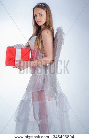 Beautiful Teen With Blonde Curly Hair And A Bow And Arrow As Cupid - Valentines Day. Cherub Girl. Bo