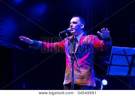 LOULE, PORTUGAL - JUNE 29: A Curva da Cintura  performs onstage in a world music festival at festival med on June 29, 2012 in Loule, Portugal.
