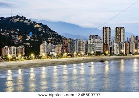 Aerial View Of A Brazilian Coastal City Of The Paulista Coast At Dusk, When The Lights Of The City S