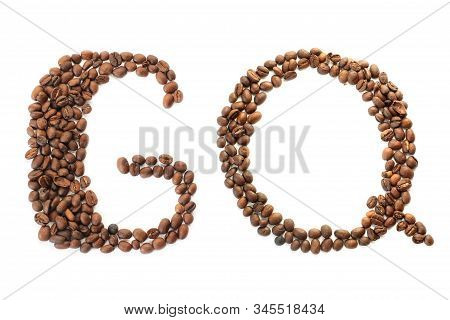 Coffee Beans. The Inscription Gq From Coffee Beans On A White Background. Brown
