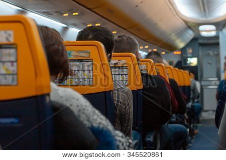 Passengers On The Airplane Cabin. People Filled Plane Airline Raynair Lowcost. Stock Photo Airplane