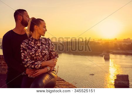 Lovely Happy Couple Enjoying At The Romantic Moment