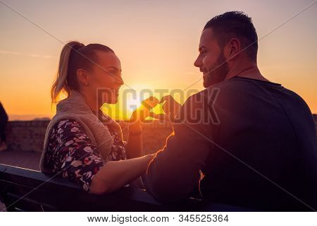 Heart And Love.happy Man And Woman  In Love At Evening Enjoying Time Together.