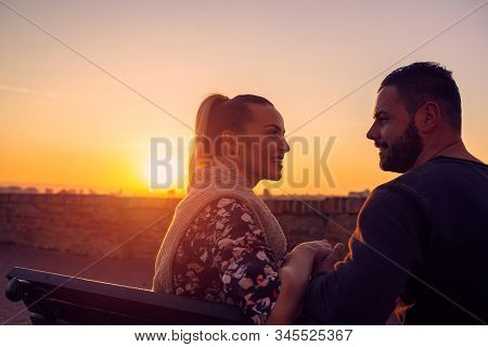 Loving Young Couple Enjoying Together At Evening