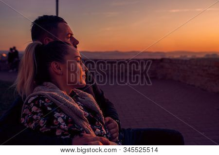 Loving Couple Watching  At Evening The Sunset