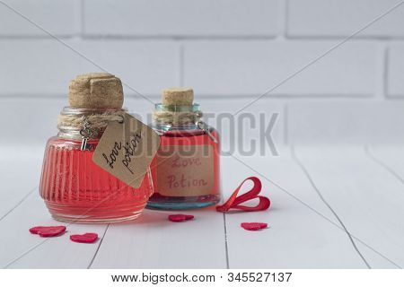 Vintage Bottles With Magic Love Potions On White Wooden Table, Space For Text