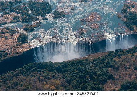 Victoria Falls Aerial View, Big Zambezi River Waterfall, Between Zimbabwe And Zambia, Africa, A Worl
