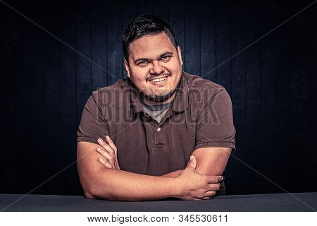 Cheerful Latino Man Smiling In A Casual Pose