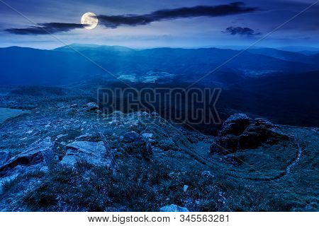 Mountain Landscape In Summer At Night. View From The Top Of Carpathian Watershed Ridge In To The Dis