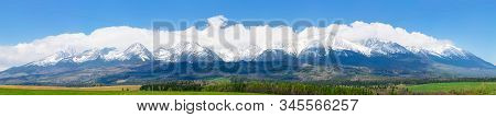 Panorama Of High Tatas Mountain Ridge In Spring. Wonderful Landscape Of Slovakia With Snow Capped Pe