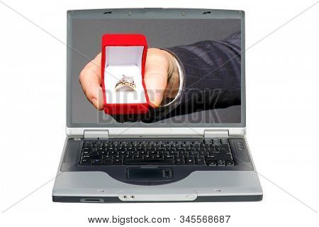 Computer Screen with Engagement Ring. A man proposes marriage via the Internet while on his computer. Wedding or Engagement Ring close up on a laptop computer screen. Isolated on white. Clipping Path