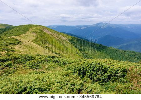 Mountain Landscape. Hiking And Tourism Concept. Rolling Hills And Distant Ridges. Green Grassy Slope
