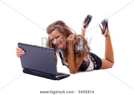 Beautiful Sexy Woman With A Laptop Lying On Floor.