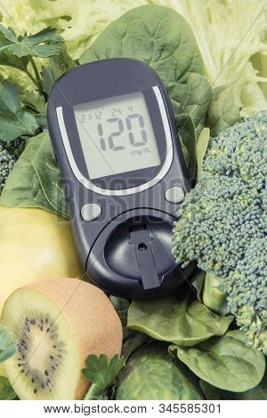 Glucometer With Result Of Sugar Level And Green Natural Fruits With Vegetables. Body Detox And Healt