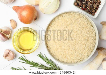 Different Ingredients On White Background, Top View. Risotto Recipe