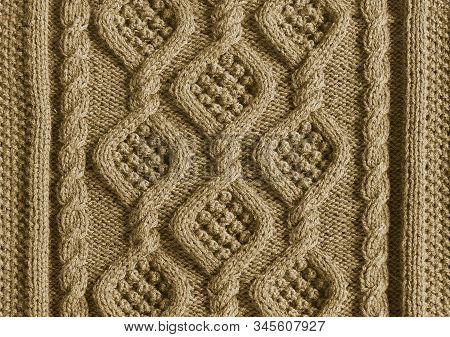 Background Texture Knitted Canvas With Patterns Aran Close Up Beige Color