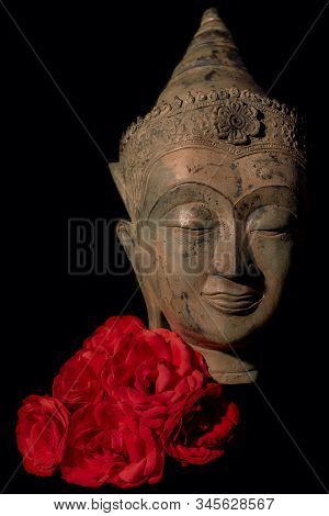 Traditional Buddhist Head Statue With Red Roses. Zen Buddhism, Mindfulness And Love. Face Of Mindful