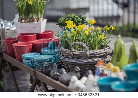 Colorful Ceramics And Fresh Flowers On The Counter Of Spring Homeware Fair