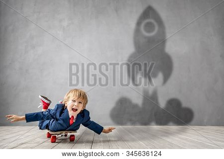 Happy Child Wants To Fly. Funny Kid Dreams Of Becoming A Rocket. Imagination, Freedom And Motivation