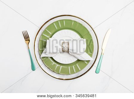 Festive Serving Plate With Golden Tableware. Transparent, Green And White Plates With Golden Fork An