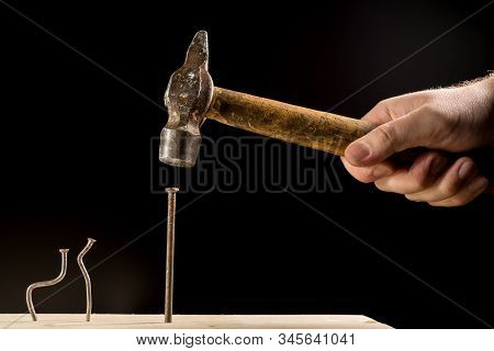 The Boss Scolds His Subordinates Because Of A Bad Mood. Two Bent Nails And One Straight. Workplace S