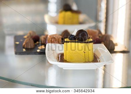 Yellow cake dessert closeup on glass table