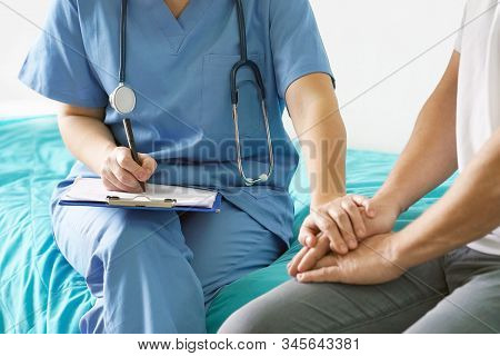 Doctor Holds The Patient's Hand.