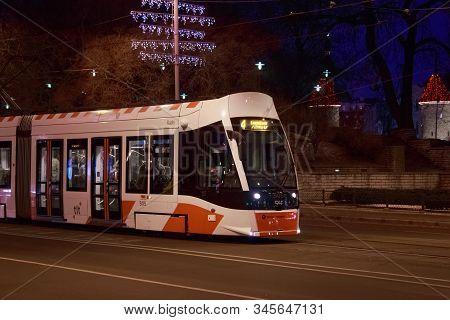 Tallinn, Estonia - January 12, 2018: Night Winter View Of Modern Caf Urbos Axl Tram In Center Part O