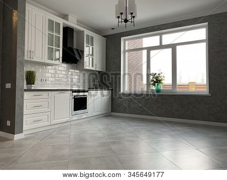 White Kitchen Furniture With Black Countertops. New Modern Kitchen With Hood And Sink.
