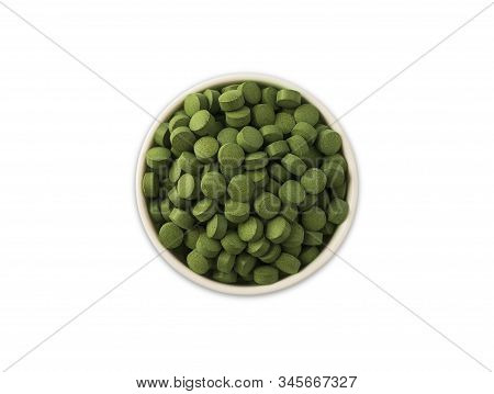 Spirulina/chlorella Tablets Isolated On White Background. Organic Spirulina And Chlorella Pills In A