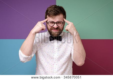 Bearded Man In Round Glasses Is Trying To Remember Something, He Is Trying Very Hard To Gather His T