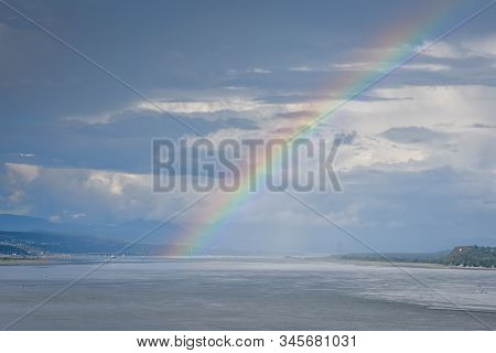 St. Lawrence River Landscape, Quebec Canada. On A Cloudy Day, With Rainbows In The Background. Conce