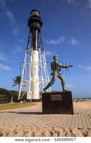 Statue Of The Barefoot Mailman James E. Hamilton Of Hillsboro Inlet