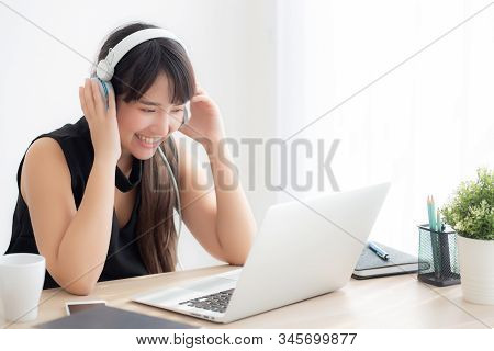 Beautiful Young Asian Woman Wear Headphone Smiling Say Hello Using Chat Video Call On Laptop Compute
