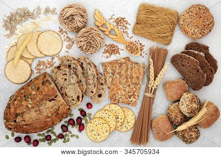 Healthy high fibre food with whole grain bread, crackers, pasta & seeds. High in antioxidants, omega 3, vitamins & protein with low GI levels. Helps to lower blood pressure & cholesterol. Flat lay.