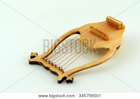 Lyre Isolated Against Light Background Close Up