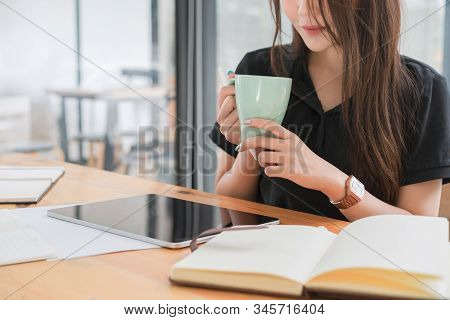 Young Beautiful Asian Accountant Woman Working On Desk Office And Drinking A Coffee.asian Woman Work