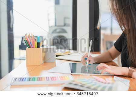 Creative Young Graphic Designer Choosing A Color From The Sampler And Drawing On A Digital Tablet Co