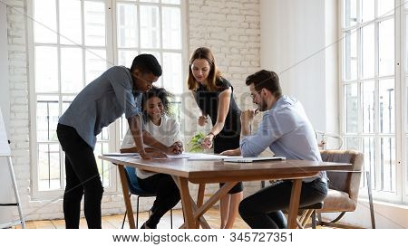 Successful Motivated Diverse Employees Team Working With Documents Together