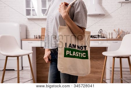 Young Girl Holding A Cloth Bag. At The Kitchen. I Am Not Plastic. Campaign To Reduce The Use Of Plas