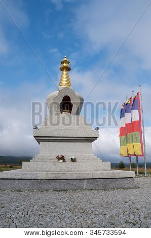 Stupa Of Enlightenment And Buddhist Flags. Buddha Statue Inside The Stupa. Buddhist Pilgrimage Sites