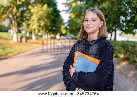 Happy Smiling Girl Teenager 12-15 Years Old, Autumn Day, Street Portrait, Summer Park. In Hand Noteb