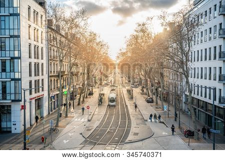 Lyon France , 4 January 2020 : Cityscape With Top View Of Lyon T1 Tram Line With Dramatic Sunset Lig